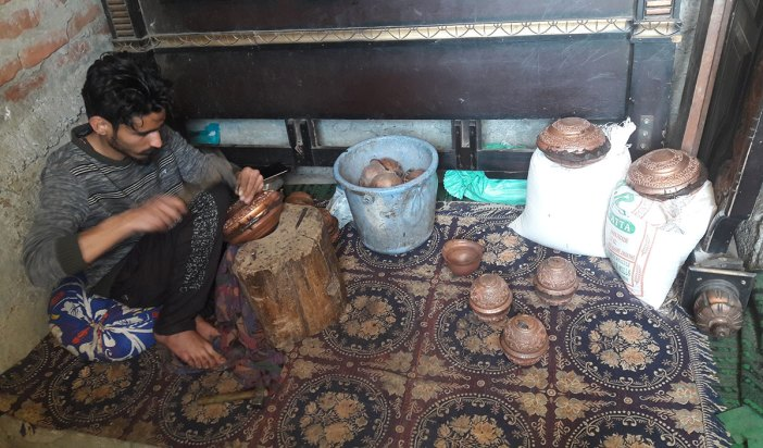 Faizan, Bashir's son working as a copper smith.
