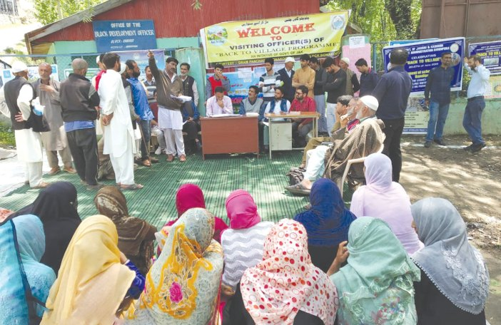 Officials with villagers during BAck to Village programme in Bandipora district.
