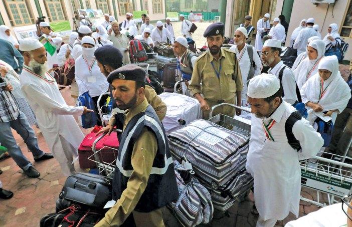 Hajj pilgrims collecting their luggage at Haj House Srinagar. KL Image by Bilal Bahadur