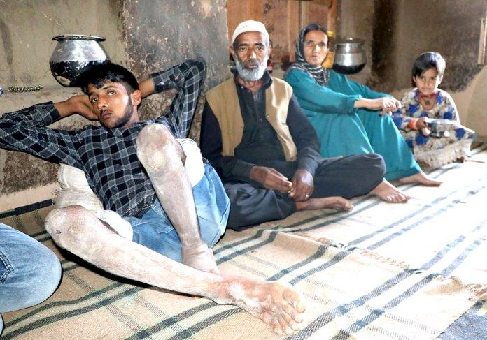 Nisar Ahmad Phamad with his family.