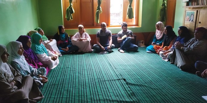 Members of different self help groups assemble for their weekly meeting at Nowgam village in Sonawari. KL Image by Shams Irfan