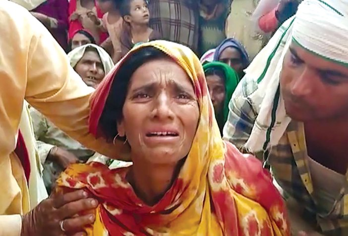 The family members of the slain driver mourning the killing in Rajasthan.