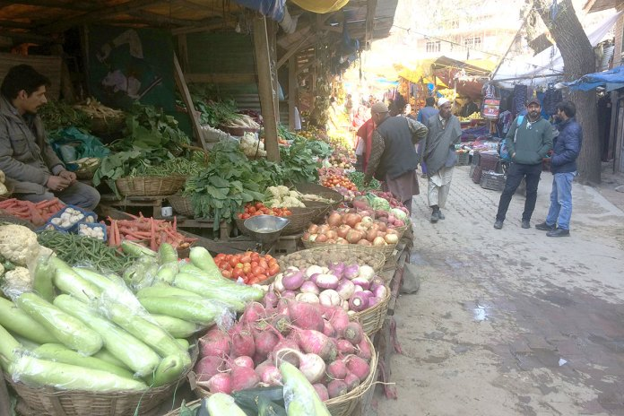 Vegetable sellers at main town Banihal. KL Image by Umar Khurshid