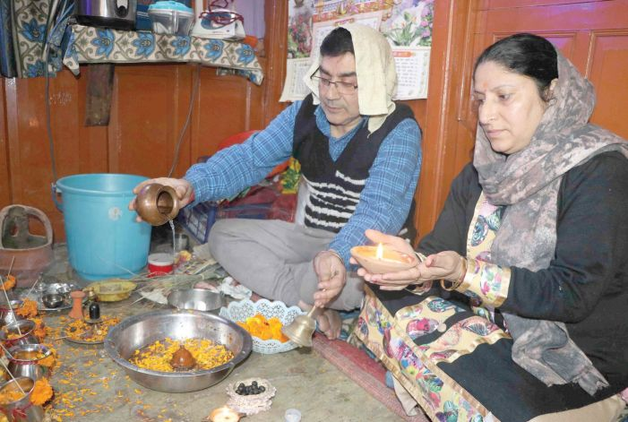 Kashmiri Pandit couple performs puja