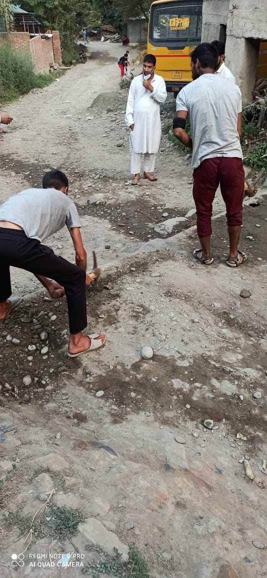 Macadamization not coming for years, Budgam villagers repair road patch with concrete