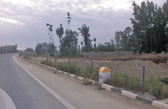 Officials feign ignorance while petrol pump is built along NH on agricultural land