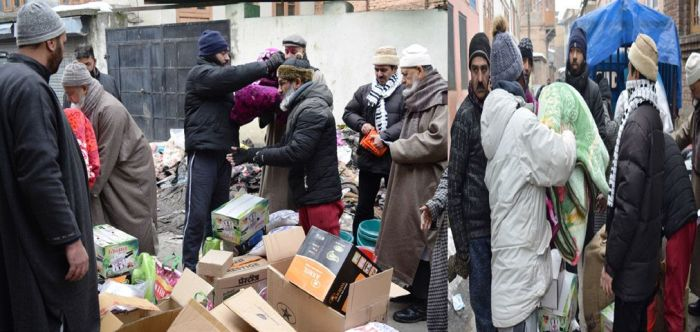 Darul Khair distributes relief material among fire victims