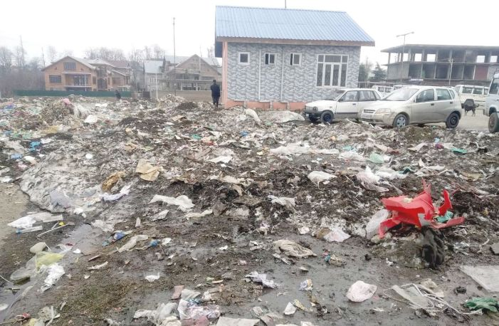 Bus stand in Shopian litters with tons of garbage left behind by piled snow