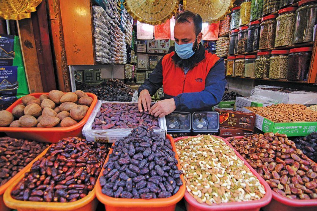 A shopkeeper sells dates in Srinagar as Ramadan starts from Wednesday