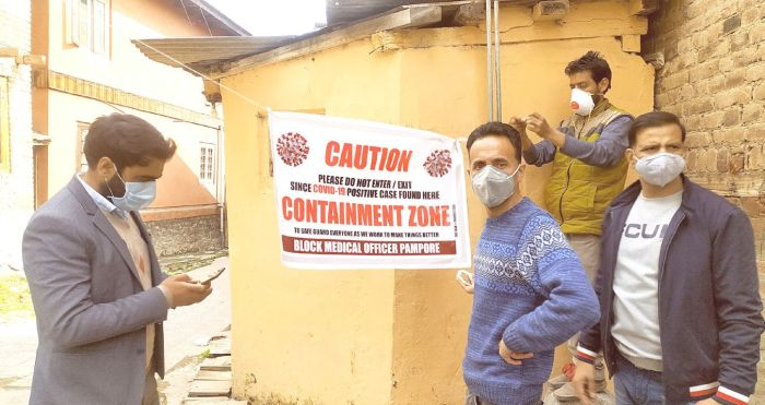 Resurgence of COVID-19: Authorities announce two mini containment zones in Pampore