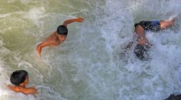 With mercury soaring in the Valley, boys take a dip in waters in Tangmarg