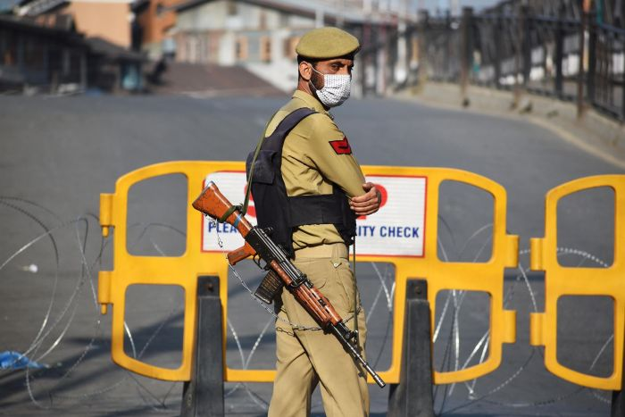 Restrictions eased in Kashmir but forces remain deployed