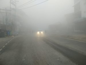 Valley under thick fog cover, poor visibility effects vehicular movement