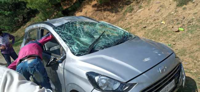 Three sustain injuries as car rolls down into deep gorge