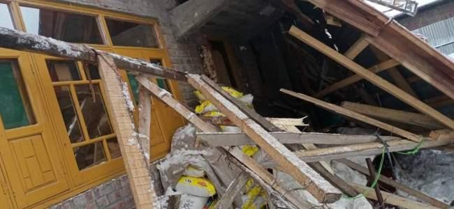 Snowfall damages residential house in Ganderbal