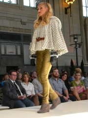 On the runway. With a cape.