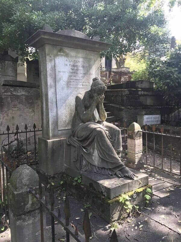 statue of a weeping woman on a grave