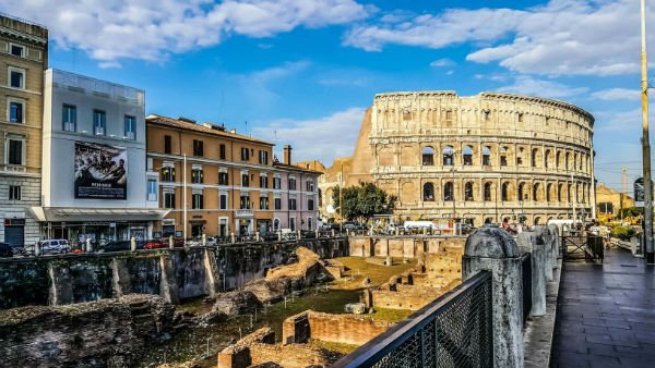 roman ruins with Colosseum in the background an important stop when you visit Rome