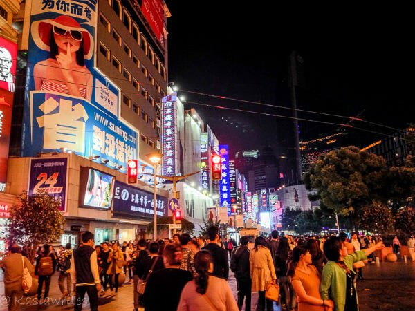 store fronts along Nanjing Road in Shanghai at night