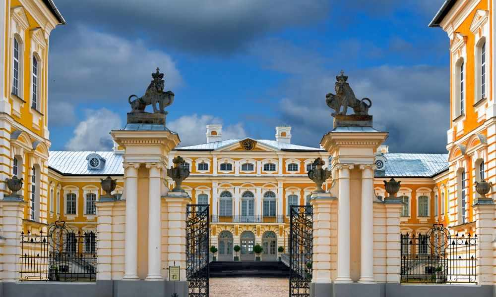 ornate entrance gates to Rundale Palace with two lions overlooking the gate