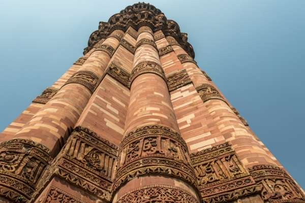 looking up Qutub Minar brick tower in Delhi
