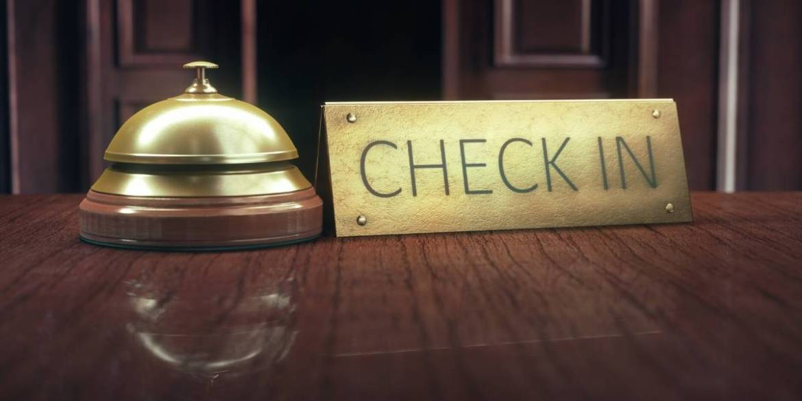 bell beside a check in sign - what does the future of travel look like