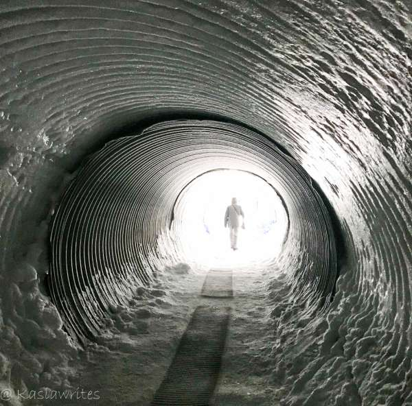 iced tunnel with a figure of a person outside
