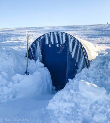 entrance to the ice cave coved with snow