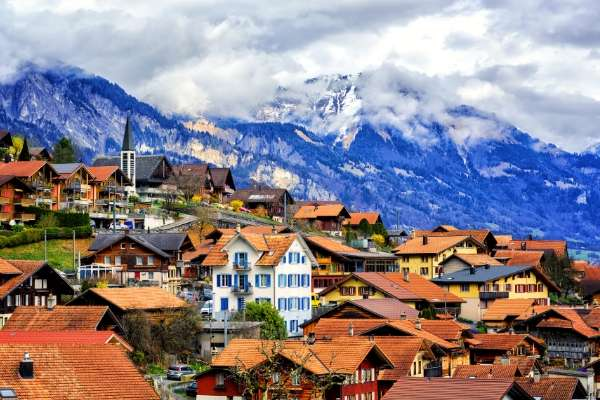 Swiss towns with mountains in the back