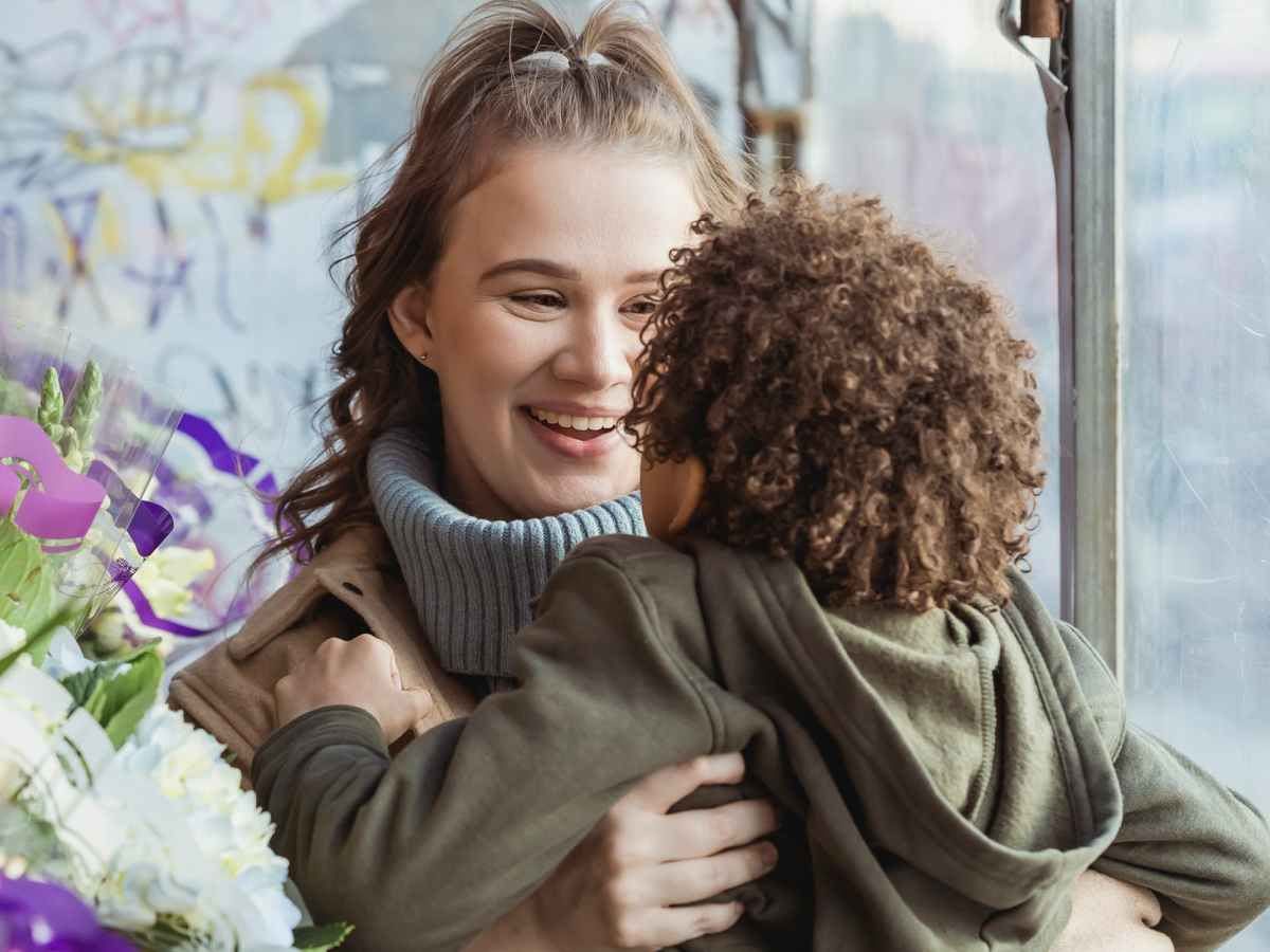 loving mother with anonymous son in floral shop