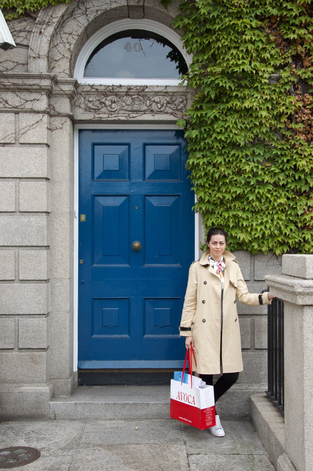 Infront of a blue door in Dublin