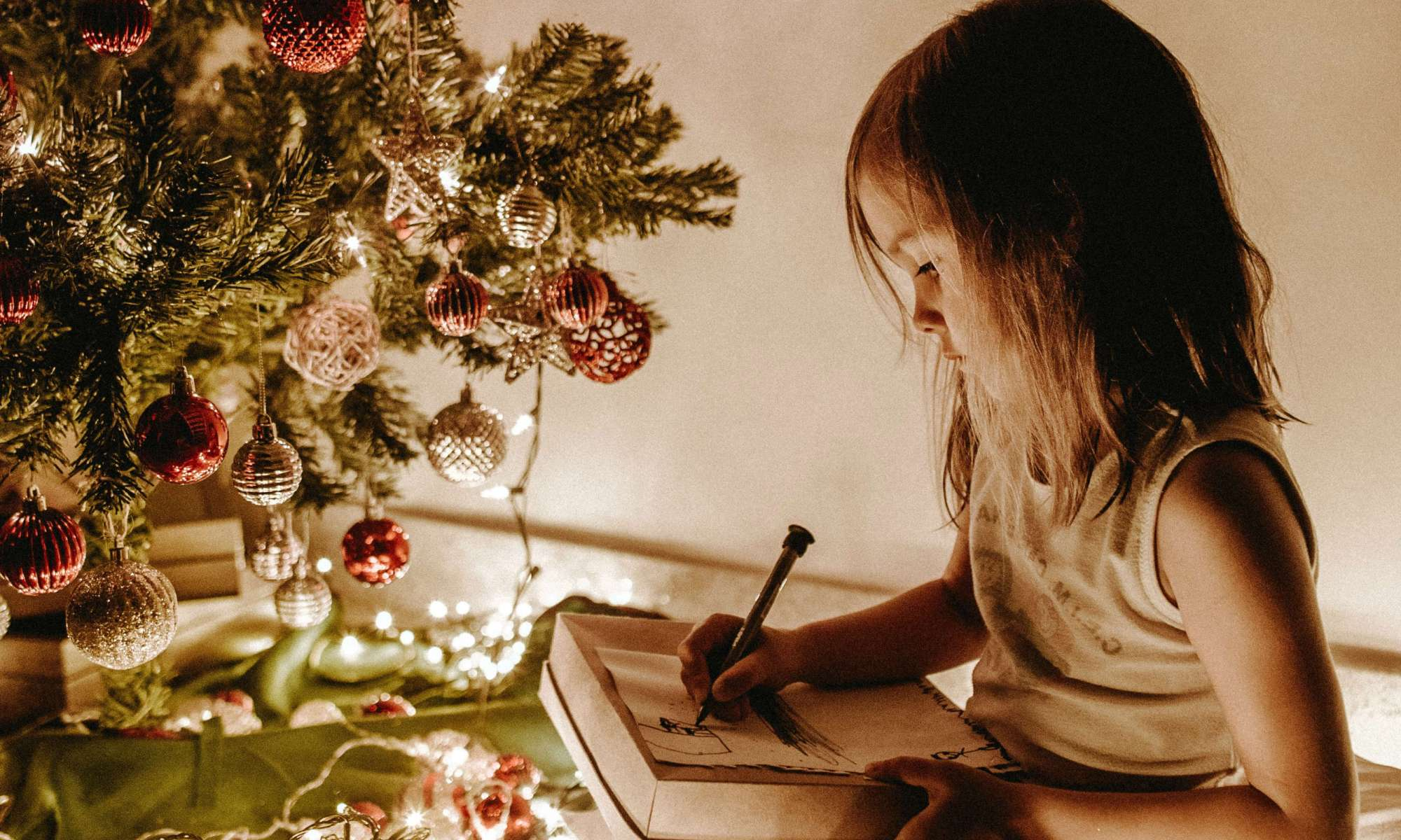 Young Girl Drawing by the Light of a Christmas Tree