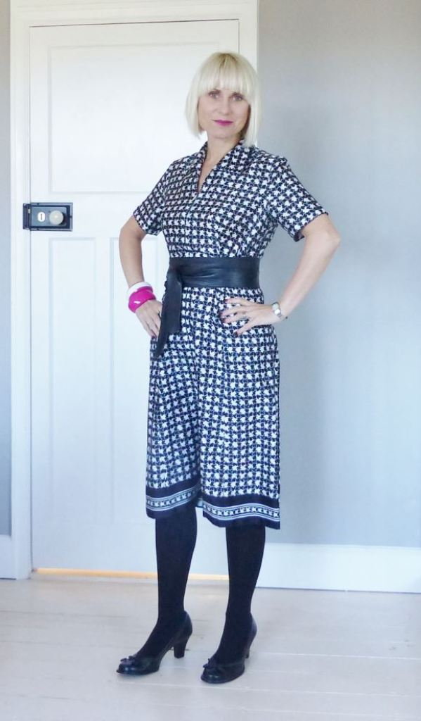 Vintage monochrome black and white fashion dress as worn by Kate Beavis Vintage Home including Clarks Shoes, Tesco F+F coat, Miss Selfridge obi belt and vintage accessories