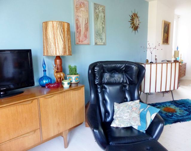 1960s vintage lounge as featured on Kate Beavis Vintage blog with swivel chairs, teak sideboard, vintage cushions