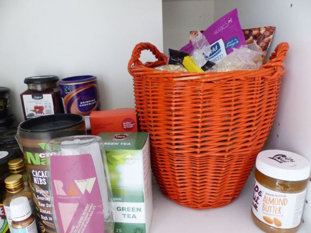 Vintage orange basket in a pantry cupboard in Kate Beavis Vintage Home blog