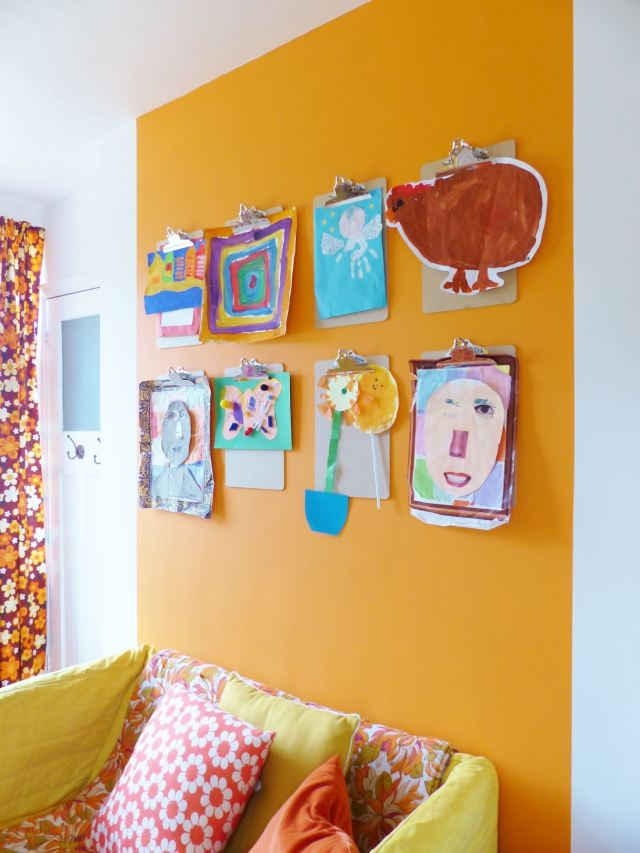 A vintage children's room by Kate Beavis.com, hanging wall art on clipboards
