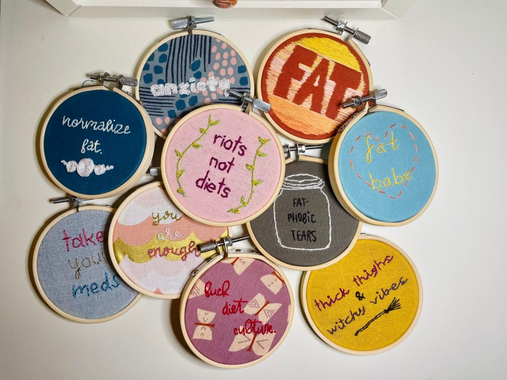 a pile of small, colorful embroidery hoops
