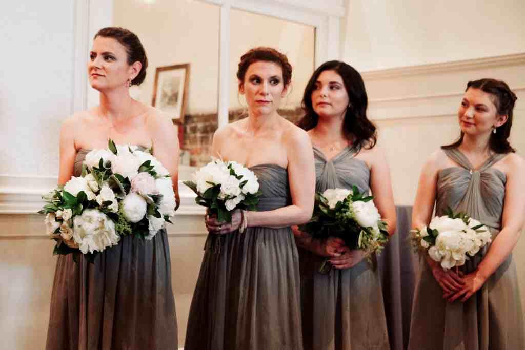 bridesmaids in grey dresses at unique wedding venue
