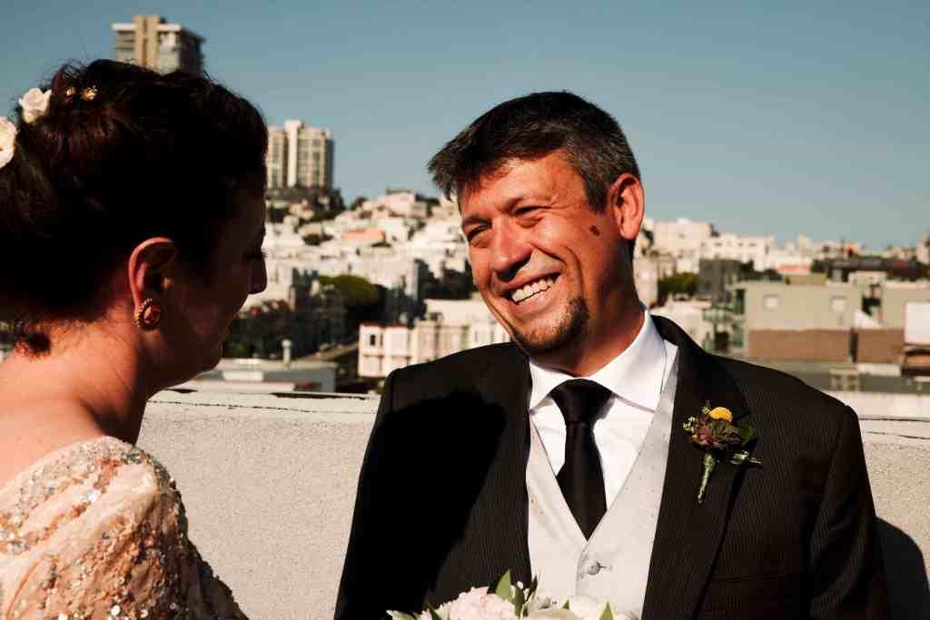 groom smiling at bride at a unique wedding venue