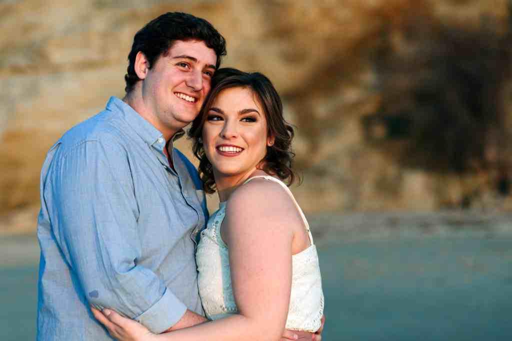 engaged couple at sunset