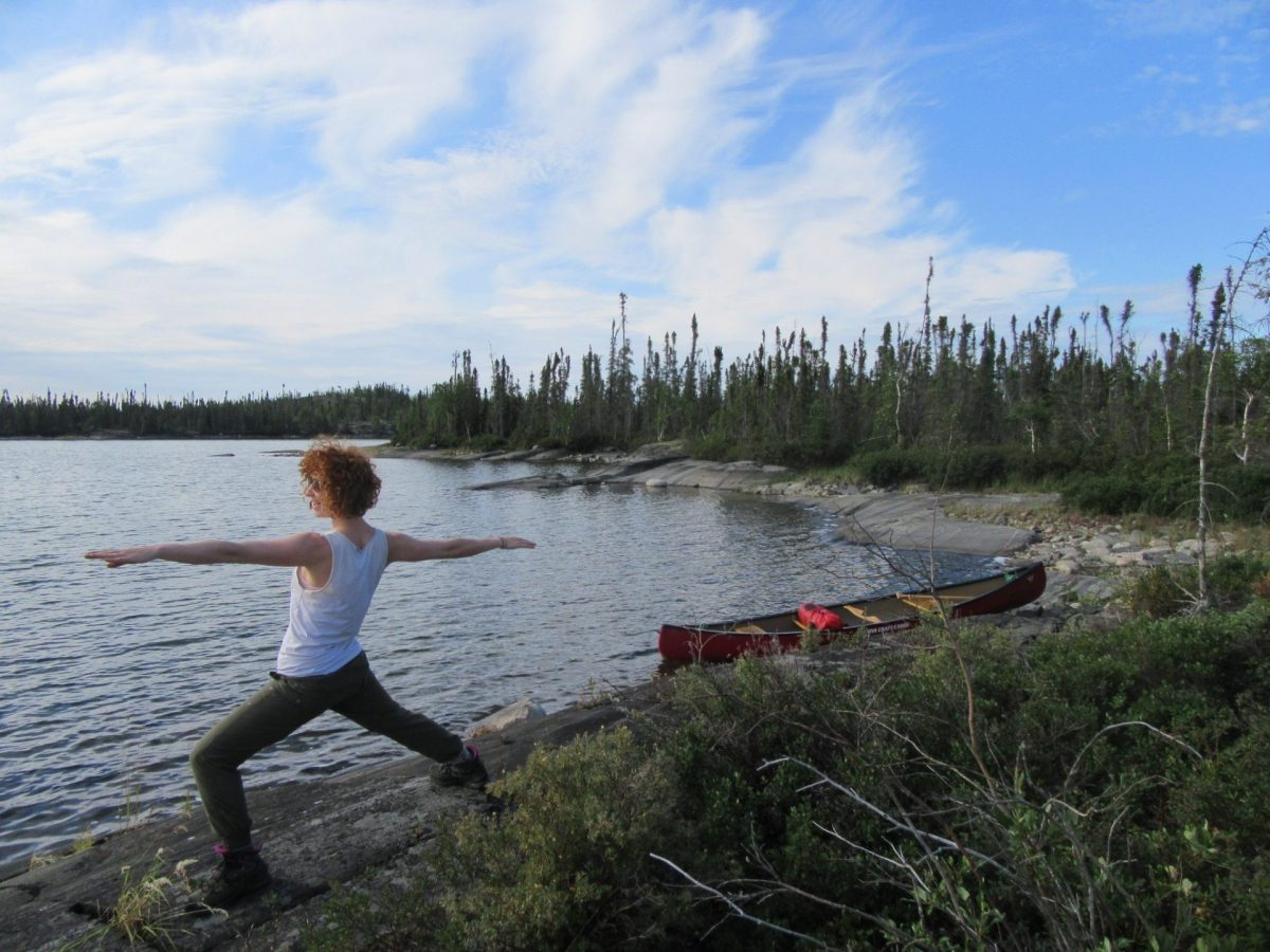 Pensive Lake Canoe Warrior Pose Online Yoga Teacher Training