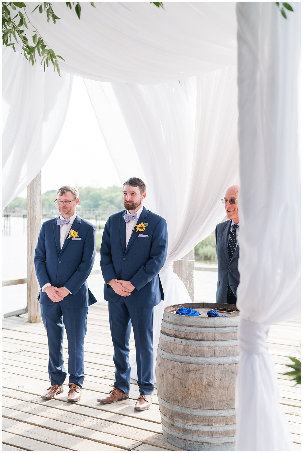 groom waits for bride for Cotton Dock wedding ceremony at Boone Hall