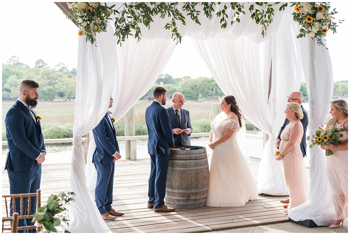 bride and groom exchange vows on Cotton Dock at Boone Hall