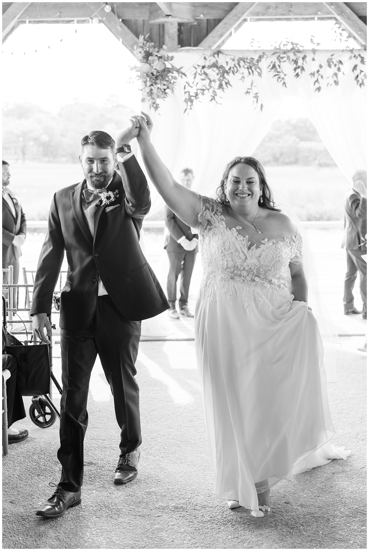 bride and groom cheer after leaving Boone Hall wedding ceremony