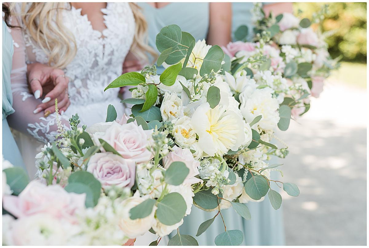 bridesmaids hold flowers before Charleston SC wedding