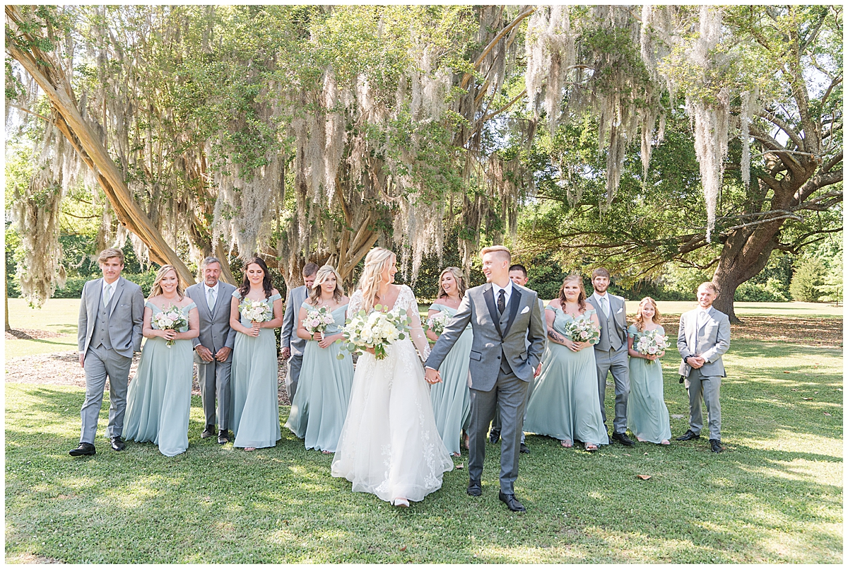 bride and groom walk with full bridal party before Cannon Green wedding
