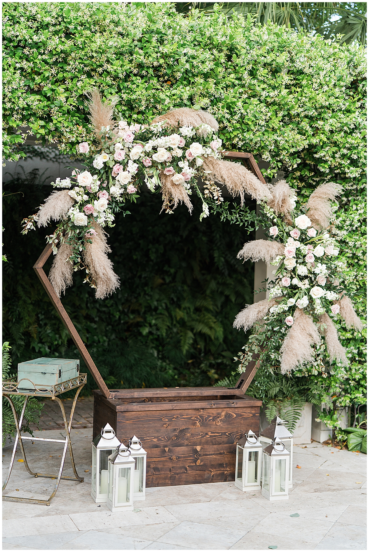 Charleston SC wedding ceremony decor with florals and feathers