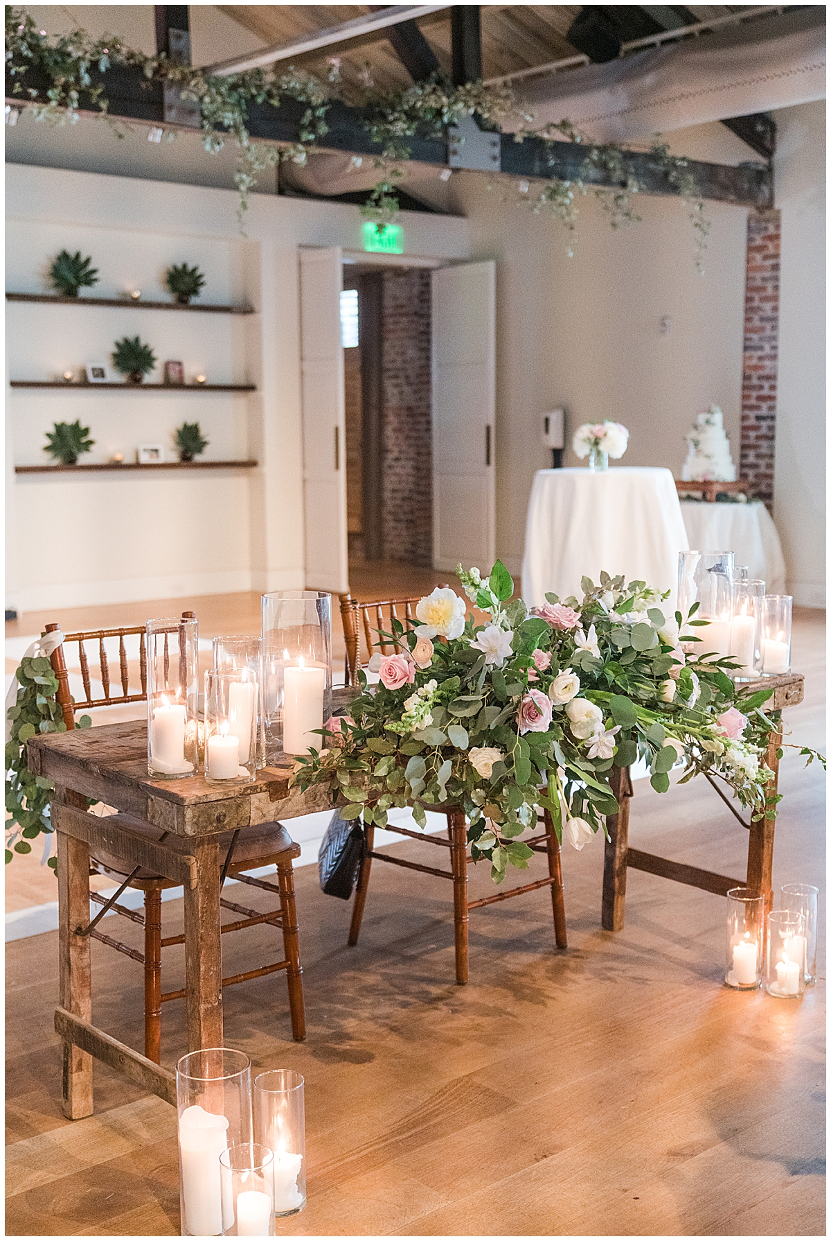 sweetheart table with big floral display in Charleston SC