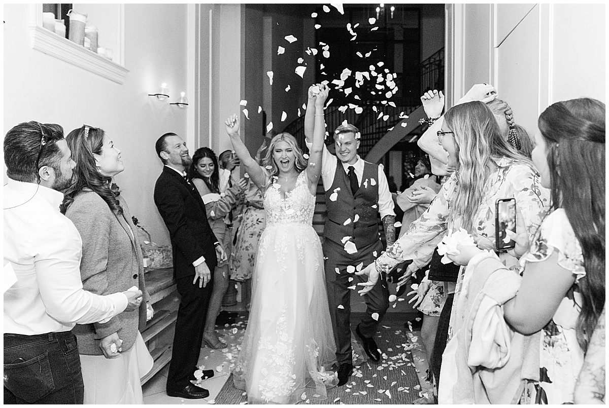 couple leaves Cannon Green wedding with flower petal exit