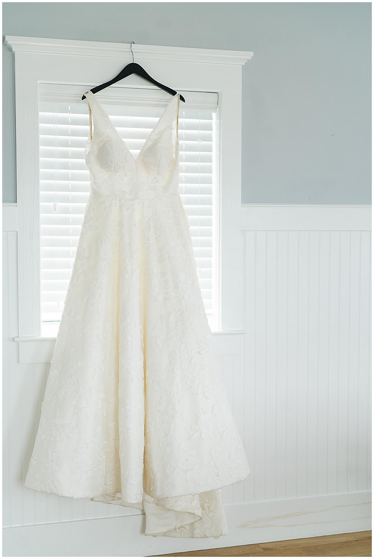 wedding dress hangs in Charleston SC wedding